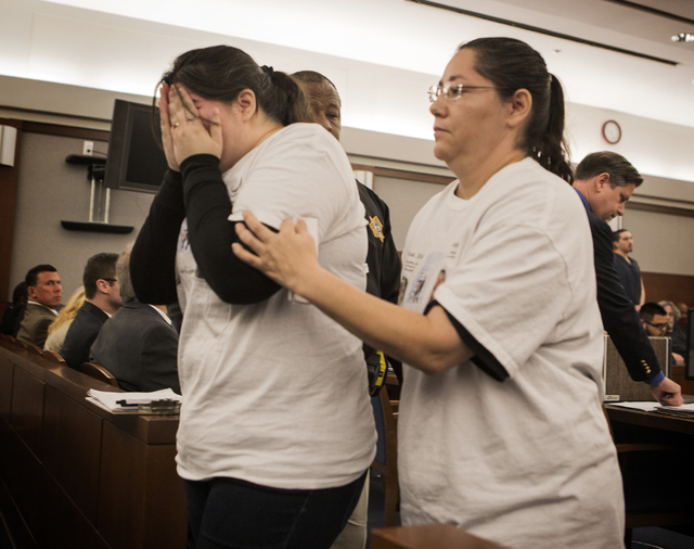 Edna Cordero, right, helps her sister Elyssa Aisa, after a victim  statement  during the sentencing of Leonardo Ruesga at Regional Justice Center on Thursday, March 3, 2016. Ruesga pleaded guilty  ...