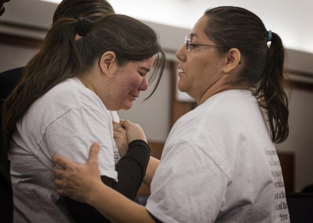 Edna Cordero, right, helps her sister Elyssa Aisa, during a victim  statement  at the sentencing of Leonardo Ruesga at Regional Justice Center on Thursday, March 3, 2016. Ruesga pleaded guilty to  ...