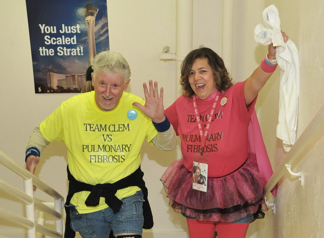 Clem and Debbie Wiechecki pass the finish line during the Feb. 28 Scale the Strat event in which participants climb 108 floors to raise money for lung research/education and raise awareness for Pu ...