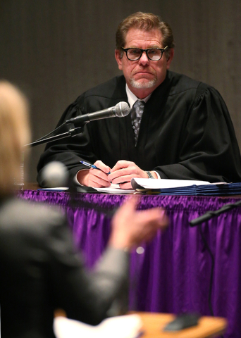 Justice Ron Parraguirre listens as attorney Kristine Brown argues before a Supreme Court panel at the Jeanne Dini Cultural Center in Yerington, Nev., on Thursday, Nov. 14, 2013.  (Cathleen Allison ...