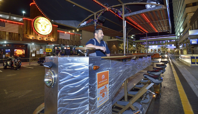 Ben Contorno, a driver for the Vegas Pub Crawler bicycle tour, waits for customers to show up at the Downtown Grand Las Vegas hotel-casino at 206 N. 3rd St. on Tuesday, March 8, 2016. Bill Hughes/ ...