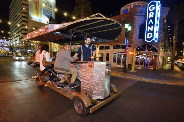 Ben Contorno, a driver for the Vegas Pub Crawler bicycle tour, right, takes passengers to Nacho Daddy after picking up them up at the Downtown Grand Las Vegas hotel-casino at 206 N. 3rd St. on Tue ...