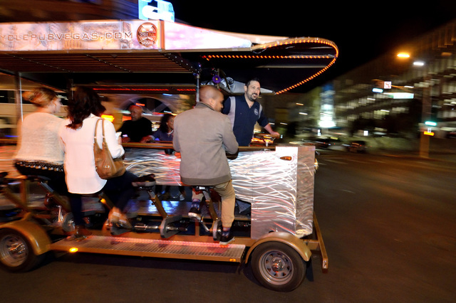 Ben Contorno, a driver for the Vegas Pub Crawler bicycle tour, turns onto Ogden Avenue from 3rd Street after picking up passengers at the Downtown Grand Las Vegas hotel-casino at 206 N. 3rd St. on ...