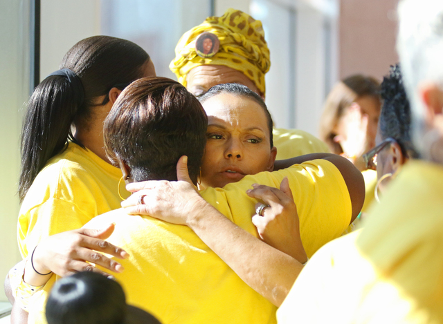 Gayla Walker Thornton, center, embraces Sheryal Wesley (cq) after they attend the sentencing of Willie Shannon at Regional Justice Center Thursday, March 10, 2016, in Las Vegas. Shannon was senten ...