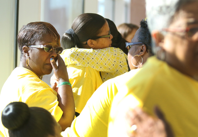 Sheryal Wesley (cq), left, wipes her eyes and LaTonya Carson, second from left, receives an embrace from Gayla Walker Thornton after they attend the sentencing of Willie Shannon at Regional Justic ...