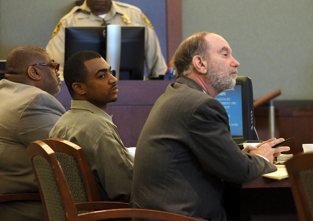 Robert Sharpe III, second from left, sits next to his attorneys, Dan Winder, left, and Arnold Weinstock during opening statements his trial at the Regional Justice Center in Las Vegas, Monday, Feb ...