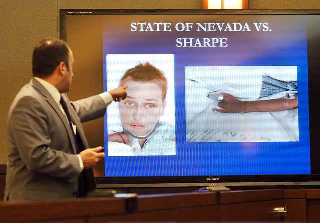 Prosecuting attorney Sam Martinez points to a photo of victim Autumn Richards during opening statements of the trial Robert Sharpe III at the Regional Justice Center in Las Vegas, Monday, Feb. 7,  ...