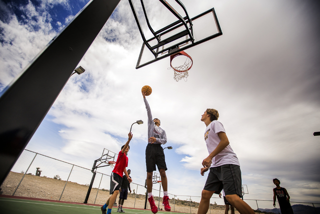 Young men play basketball at the Skye Canyon Park at Sky Canyon, the city's newest master plan, on Monday, March 21, 2016. Jeff Scheid/Las Vegas Review-Journal Follow @jlscheid