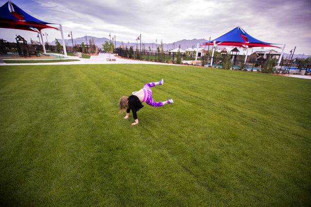 Kaylee Aberg, 6, attempts a cartwheel in the play field at Skye Canyon Park on Monday, March 21, 2016. Jeff Scheid/Las Vegas Review-Journal Follow @jlscheid
