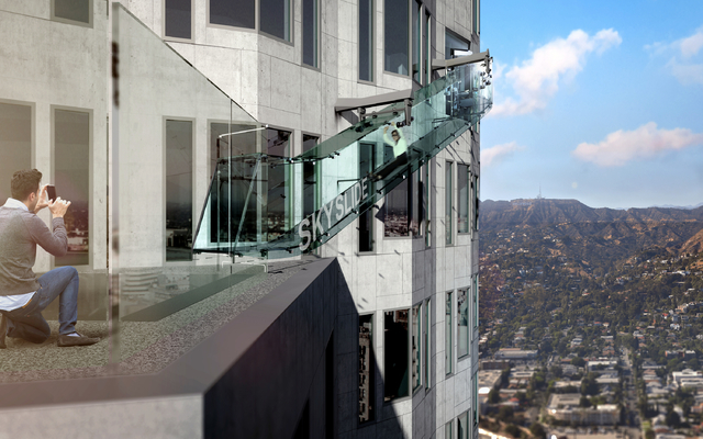 This undated artist's rendering provided by Overseas Union Enterprise Limited shows a glass slide 1,000 feet above the ground off the side of the U.S. Bank Tower in downtown Los Angeles. Michael L ...