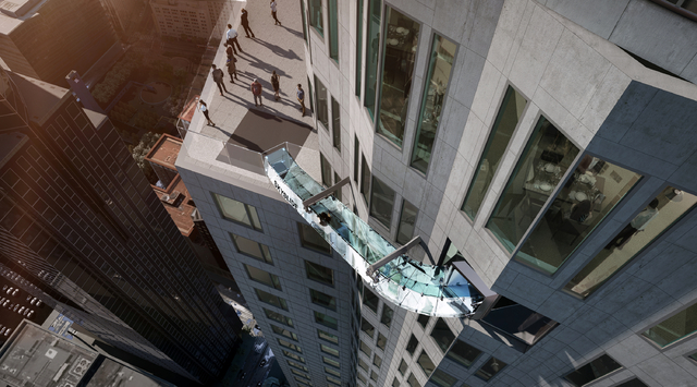 This undated artist's rendering provided by Overseas Union Enterprise Limited shows plans for a glass slide 1,000 feet above the ground off the side of the U.S. Bank Tower in downtown Los Angeles. ...