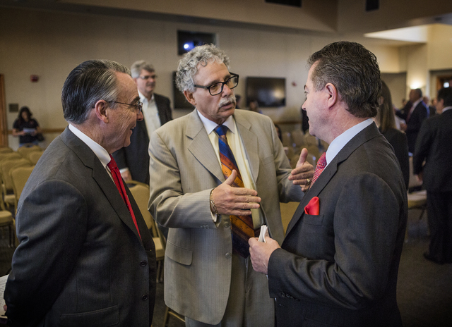 UNLV stadium pointman Don Snyder, left, Mark Rosentraub, professor of sports management at University of Michigan and Len Jessup, president of UNLV, talk before the Southern Nevada Tourism Infrast ...
