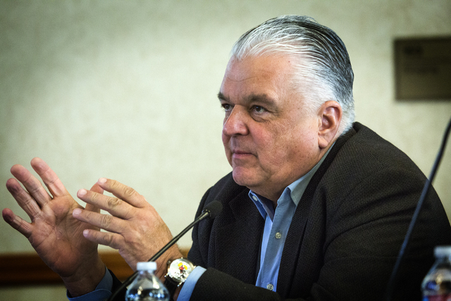 Southern Nevada Tourism Infrastructure Committee board member Steve Sisolak, Clark County Commission Cairman, asks a question to Len Jessup, president of UNLV, during the hearing on the proposed n ...