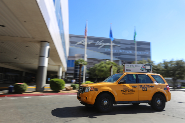 A taxi cab pulls up to the Las Vegas Convention Center on Thursday, Oct. 22, 2015 in Las Vegas. Brett LeBlanc/Las Vegas Review-Journal Follow @bleblancphoto