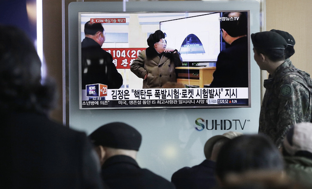 South Korean army soldiers pass by a TV screen showing North Korean leader Kim Jong Un during a news program, at Seoul Railway Station in Seoul, South Korea, Tuesday, March 15, 2016. (AP Photo/Ahn ...