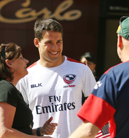 USA Menճ Eagles Sevens Olympic rugby team captain Madison Hughes, center meets with fans Marcia Shand, left, and her husband Gordon, both of Denver, during a pep rally outside Monte Carlo ho ...