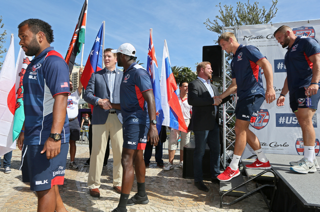 USA Sevens' Dan Lyle, second from left, executive vice president and tournament director; and Rob Cornelius, third from right, vice president of business development; shake hands with USA Men&#x57 ...