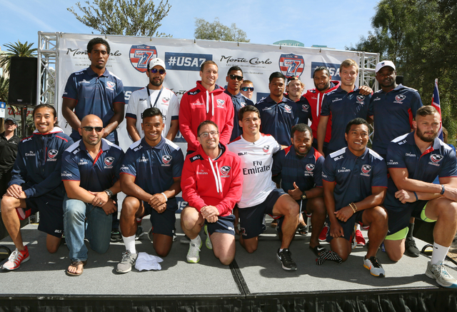 USA Menճ Eagles Sevens Olympic rugby team pose for a team photo with head coach Mike Friday, front in red, during a pep rally outside Monte Carlo hotel-casino Wednesday, March 2, 2016, in La ...