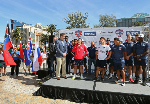 USA Menճ Eagles Sevens Olympic rugby team head coach Mike Friday, center in red, speaks during a pep rally outside Monte Carlo hotel-casino Wednesday, March 2, 2016, in Las Vegas. The Eagles ...