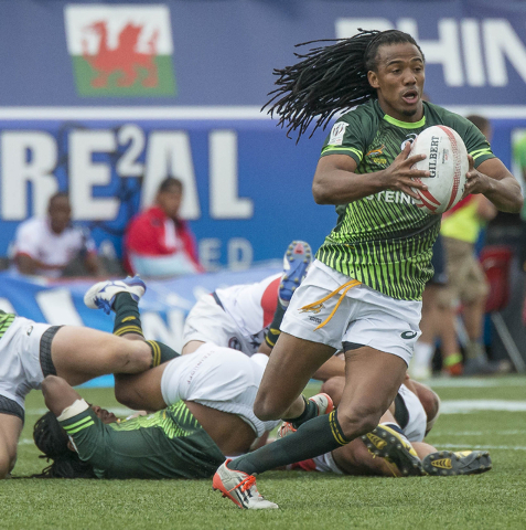JACOB KEPLER/LAS VEGAS REVIEW-JOURNAL South Africa's Justin Geduld scores against the United States during their final pool-play match in the USA Sevens rugby tournament at Sam Boyd Stadium on Sat ...