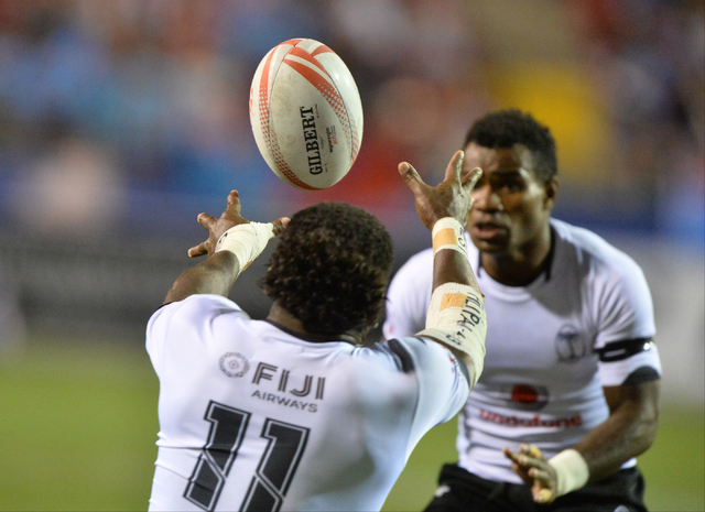 Fiji sevens player Savenaca Rawaca (11) loses his grip on the ball during the HSBC World Rugby Sevens Series on Friday, March 4, 2016, at Sam Boyd Stadium in Las Vegas. Brett Le Blanc/Las Vegas Re ...
