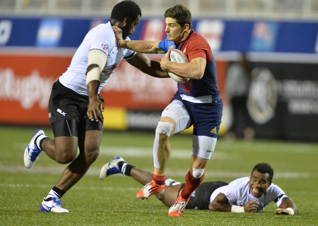 French sevens player Steeve Barry (6) stiff-arms Fiji player Lasivesi Dakuwaqa (1) during the HSBC World Rugby Sevens Series on Friday, March 4, 2016, at Sam Boyd Stadium in Las Vegas. Brett Le Bl ...