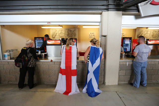 A fan of Scotland and a fan of England stand at the concession counter during final day of the HSBC World Rugby Sevens Series at Sam Boyd Stadium on Sunday, March 6, 2016. Brett Le Blanc/Las Vegas ...