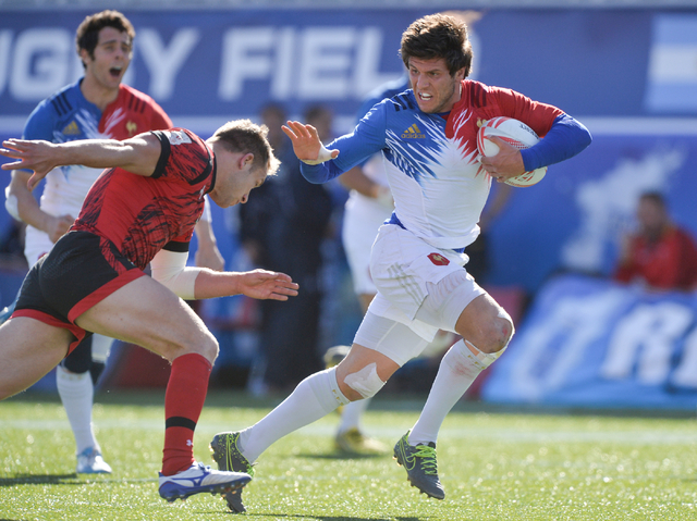 Jeremy Aicardi (9), of France, stiff-arms a Welsh defender during the final day of the HSBC World Rugby Sevens Series at Sam Boyd Stadium on Sunday, March 6, 2016. Brett Le Blanc/Las Vegas Review- ...