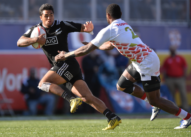 Regan Ware (3), of New Zealand, breaks an attempted tackle from Lote Tuqiri (2), of Japan, during the final day of the HSBC World Rugby Sevens Series at Sam Boyd Stadium on Sunday, March 6, 2016.  ...