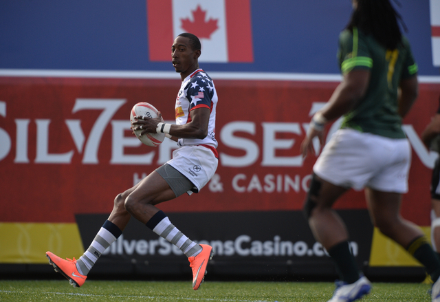 Perry Baker (11), of the United States, scores a try during the final day of the HSBC World Rugby Sevens Series at Sam Boyd Stadium on Sunday, March 6, 2016. Brett Le Blanc/Las Vegas Review-Journa ...