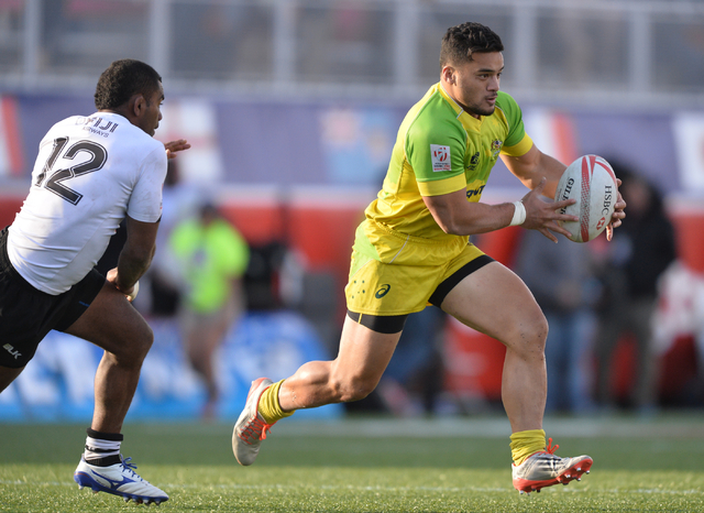 Allan Fa'alavu'au (10), of Australia, is chased down by Vatemo Ravouvou (12), of Fiji during the championship game of the HSBC World Rugby Sevens Series at Sam Boyd Stadium on Sunday, March 6, 201 ...