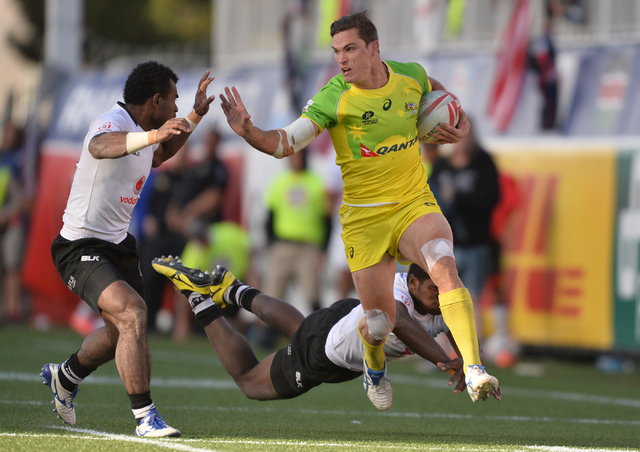 Ed Jenkins (9), of Australia, is brought down by Emosi Mulevoro (8), of Fiji, during the championship game of the HSBC World Rugby Sevens Series at Sam Boyd Stadium on Sunday, March 6, 2016. Fiji  ...