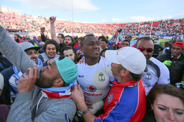 Isake Katonibau (4), of Fiji, is swamped by fans after winning the Las Vegas leg of HSBC World Rugby Sevens Series 21-15 over Australia at Sam Boyd Stadium on Sunday, March 6, 2016. Brett Le Blanc ...