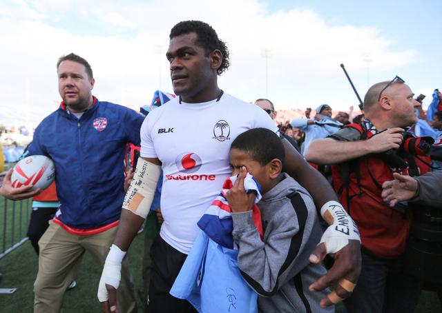 Savenaca Rawaca (11), of Fiji, walks off the field after winning the championship game of the HSBC World Rugby Sevens Series at Sam Boyd Stadium on Sunday, March 6, 2016. Fiji won, 21-15. Brett Le ...