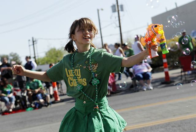 Kaitlin Larson, 7, dances with her bubble gun during the 48th annual Southern Nevada Sons & Daughters of Erin St. Patrick's Day Parade & Festival in Henderson on March 15, 2014. View fil ...