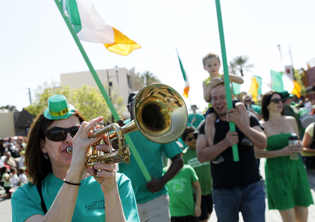 Julie Jackson, left, plays her trumpet for Grape Expectations during the 48th annual Southern Nevada Sons & Daughters of Erin St. Patrick's Day Parade & Festival in Henderson on March 15 ...