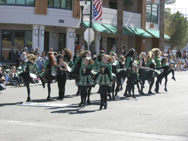 Dancers from the Sharon Lynn Academy of Irish Dance stop to perform during 44th annual Southern Nevada Sons & Daughters of Erin St. Patrick's Day Parade & Festival on Water Street on Mar ...