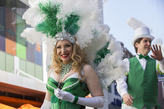 Heather Burdette, left, walks in the St. Patrick's Day parade in The Linq promenade during the O'Sheas BLOQ party, Thursday, March 17, 2016, in Las Vegas. Benjamin Hager/Las Vegas Review-Journal
