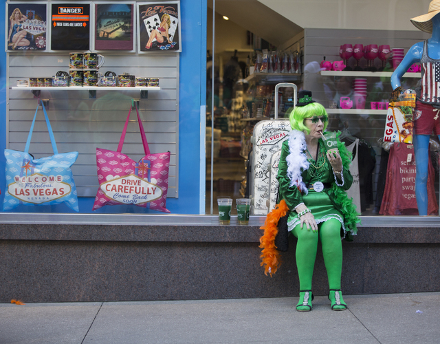 """Annie Taylor, of Belfast, Ireland, sips her beverage during the St. Patrick's Day parade in The Linq promenade during the O'Sheas BLOQ party, Thursday, March 17, 2016, in Las Vegas. """"We come her ..."""