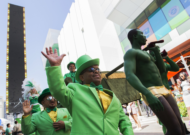Mike Angelo, middle, waives to the crowd during St. Patrick's Day parade in The Linq promenade during the O'Sheas BLOQ party, Thursday, March 17, 2016, in Las Vegas. Benjamin Hager/Las Vegas Rev ...