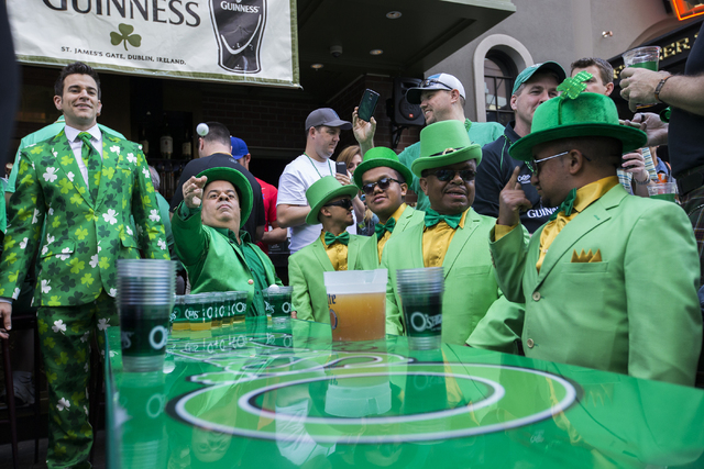"""Brian """"Lucky"""" Thomas makes his toss during a game a beer pong at The Linq promenade during the O'Sheas BLOQ party, Thursday, March 17, 2016, in Las Vegas. Benjamin Hager/Las Vegas Review-Journal"""