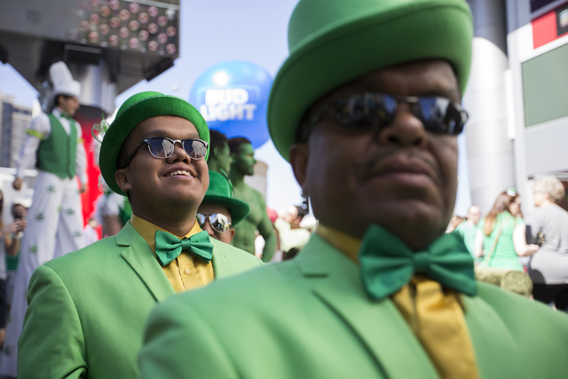 Roberto Romero, left, get's ready to start marching during St. Patrick's Day parade in The Linq promenade during the O'Sheas BLOQ party, Thursday, March 17, 2016, in Las Vegas. Benjamin Hager/La ...