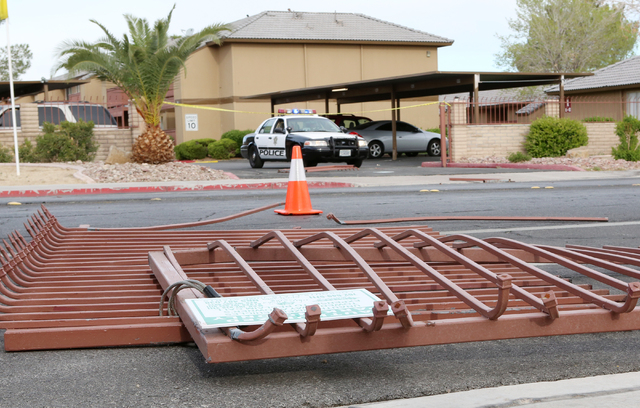 A fallen metal gate is seen lying on the ground after a man rams his vehicle into the Enclave-University Town Center apartment complex gate on 4801 Spencer St., near Tropicana Avenue Wednesday, Ma ...