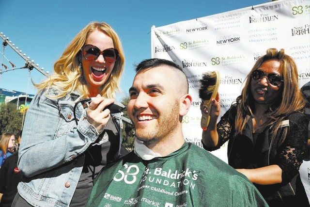 Kristen Hertzenberg of Million Dollar Quartet helps shave heads for St. Baldrick's at New York-New York on March 7, 2015. This year's event is set for March 12. Courtesy photo