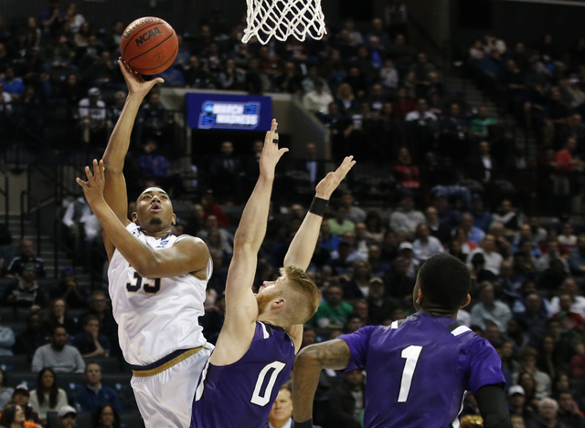 Notre Dame forward Bonzie Colson (35) shoots as Stephen F. Austin forward Thomas Walkup (0) defends during the first half of a second-round NCAA men's college basketball tournament game, Sunday, M ...