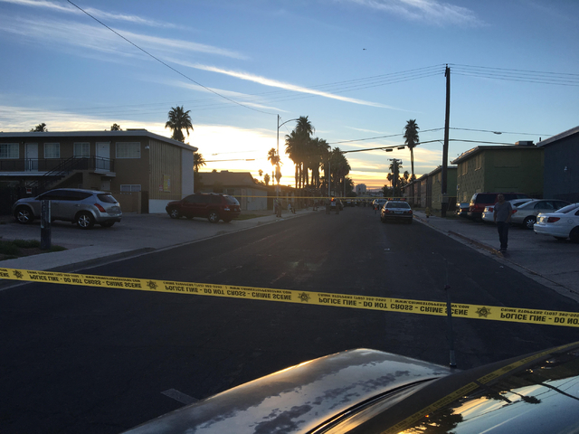 Crime scene tape blocks access to a neighborhood as police investigate reports of a stabbing near downtown Las Vegas on Tuesday, March 1, 2016. Kimber Laux/Las Vegas Review-Journal