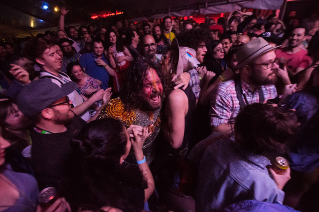 Zapot Mgwana, center, of Golden Dawn Arkestra gets in the crowd while performing at Maggie Mae's during the first night of the SXSW music festival in downtown Austin, Texas on Tuesday, March 15, 2 ...