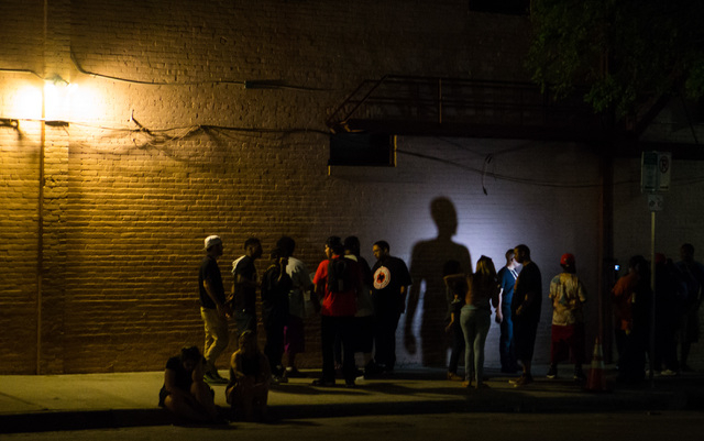 A man's shadow is cast against a wall during an interview on the first night of the SXSW music festival in downtown Austin, Texas on Tuesday, March 15, 2016. Chase Stevens/Las Vegas Review-Journal ...
