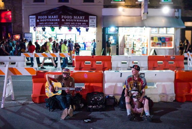 People sit along 6th Street during the first night of the SXSW music festival in downtown Austin, Texas on Tuesday, March 15, 2016. Chase Stevens/Las Vegas Review-Journal Follow @csstevensphoto