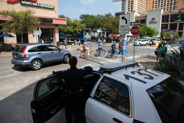 A police officer watches the crowd during the second day of the SXSW music festival in downtown Austin, Texas on Wednesday, March 16, 2016. Chase Stevens/Las Vegas Review-Journal Follow @csstevens ...
